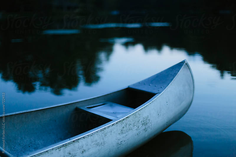 Canoe at Lake by Raymond Forbes LLC for Stocksy United