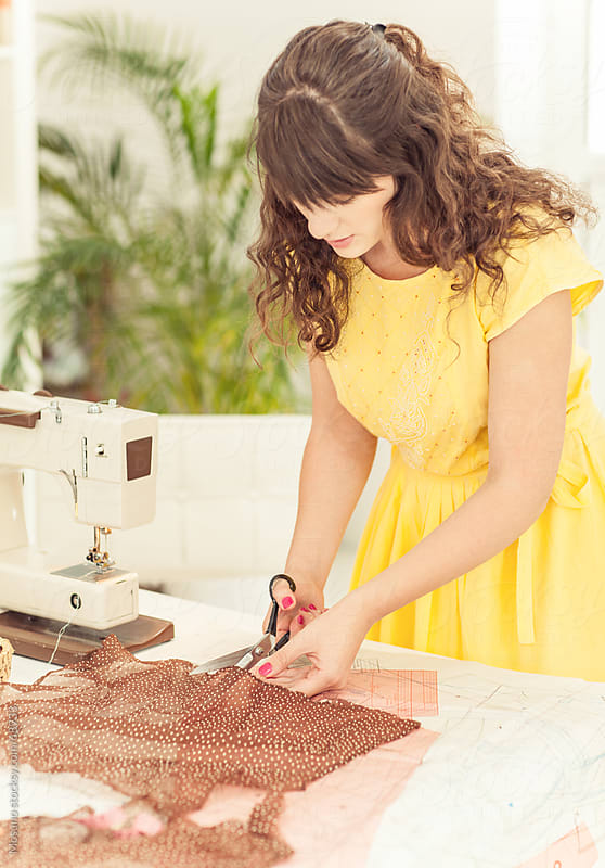 Woman Sewing a Dress by Mosuno for Stocksy United