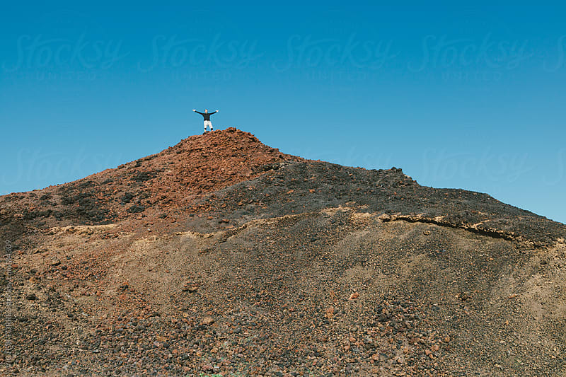 Man on Volcanic Mountain by VICTOR TORRES for Stocksy United