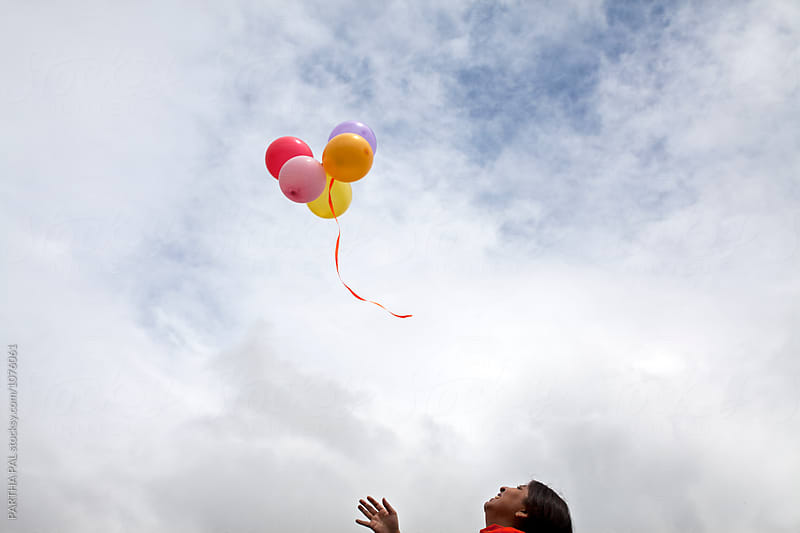Woman flying balloon in open air by PARTHA PAL for Stocksy United