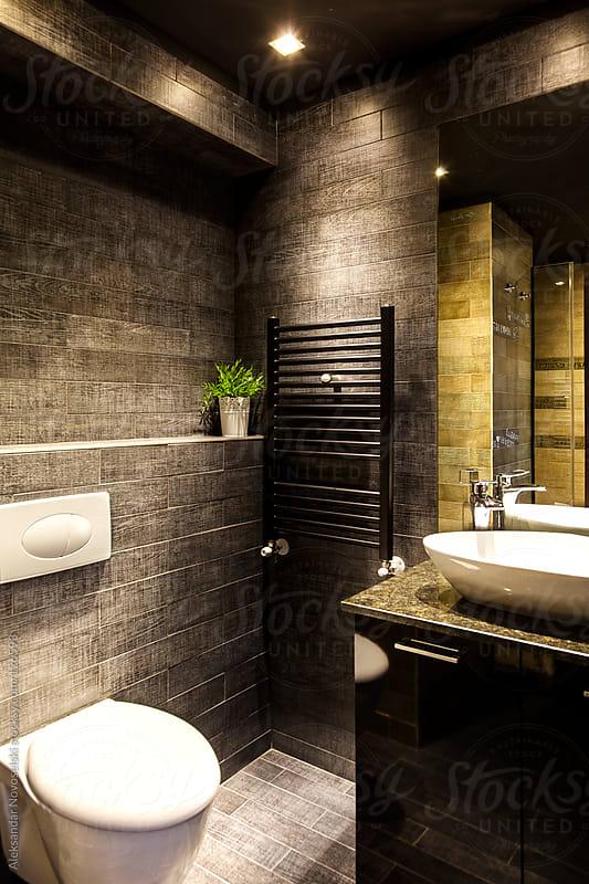 Modern dark bathroom by Aleksandar Novoselski for Stocksy United