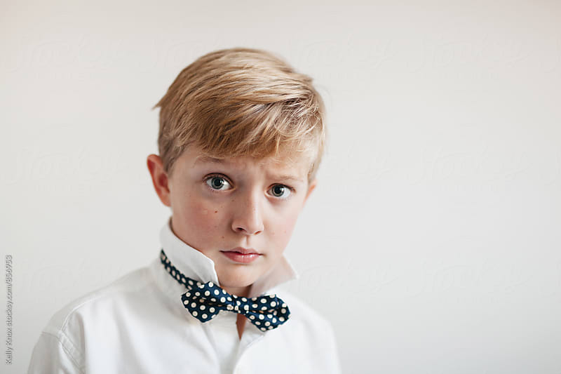 portrait of a handsome boy wearing a bowtie  by Kelly Knox for Stocksy United
