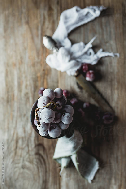 Frozen grapes by Tatjana Ristanic for Stocksy United