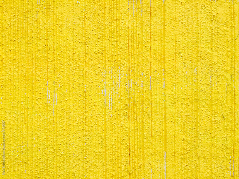 Yellow paint covering graffiti tags on urban wall, close up by Paul Edmondson for Stocksy United