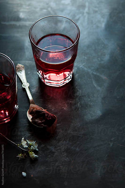 Cranberry and pomegranate herbal tea  by Nadine Greeff for Stocksy United