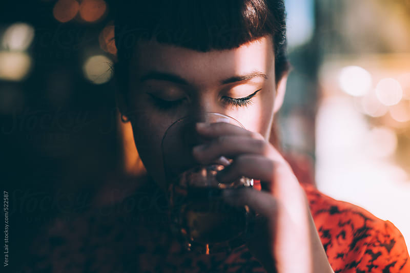 Beautiful woman drinking in the sunshine by Vera Lair for Stocksy United