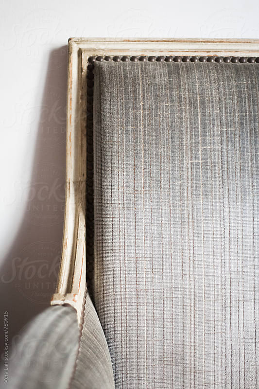 Detail of a old grey armchair by Vera Lair for Stocksy United