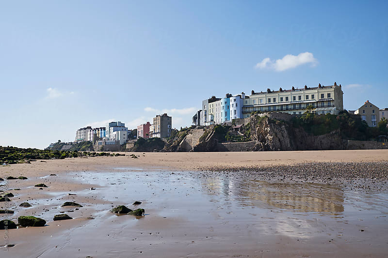 Buildings on the cliff top. Tenby, Wales, UK. by Liam Grant for Stocksy United