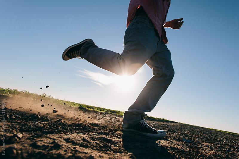 Man Dancing on Dirt Road by Stephen Morris for Stocksy United