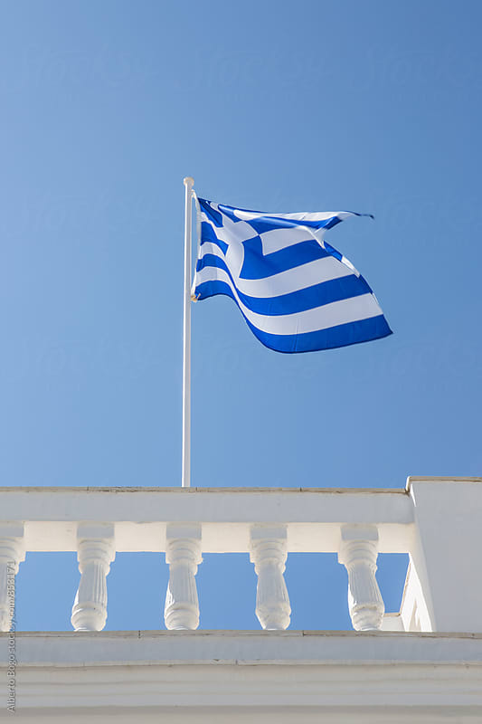 Greece flag in the wind by Alberto Bogo for Stocksy United
