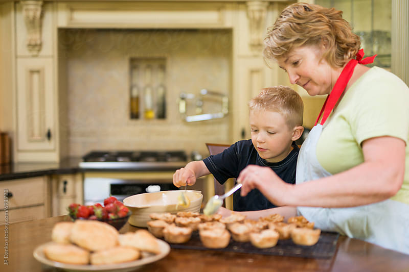 Grandmother and Grandson Baking Pastry Custard and Strawberry Tarts from Scratch Together by JP Danko for Stocksy United
