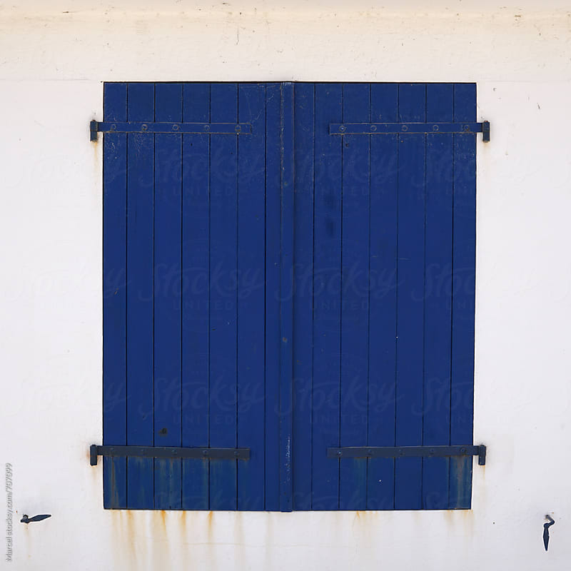 Blue shutters on a house in france by Marcel for Stocksy United