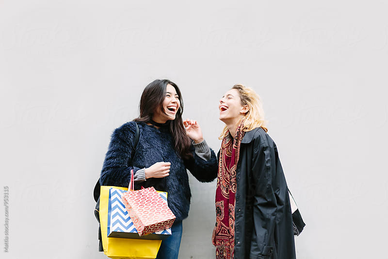 Friends Doing Shopping White Background by Mattia Pelizzari for Stocksy United