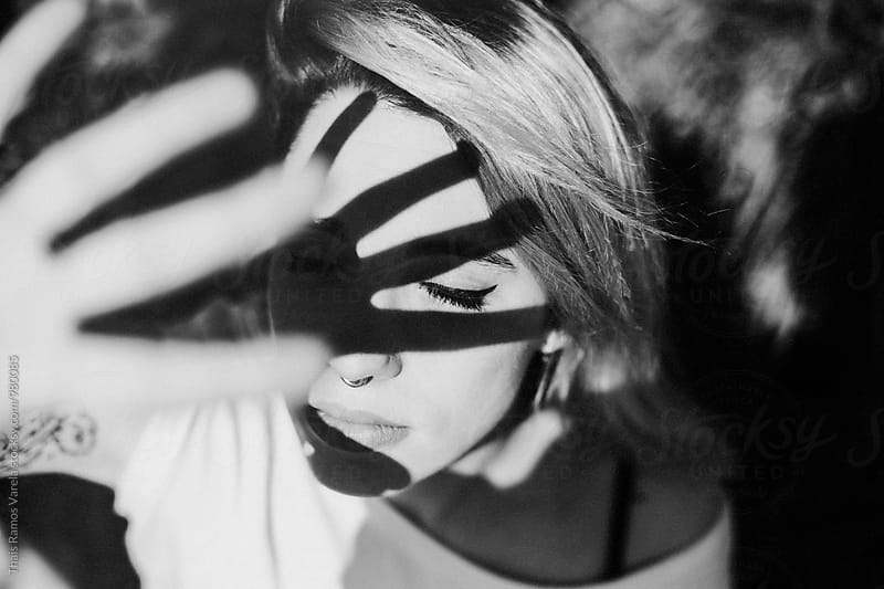 black and white portrait of a woman by Thais Ramos Varela for Stocksy United