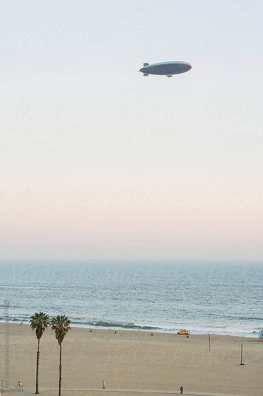 Zeppelin airship over Santa Monica beach at sunset by Per Swantesson for Stocksy United