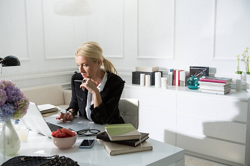 Blonde Businesswoman Working at Her Office by Lumina for Stocksy United