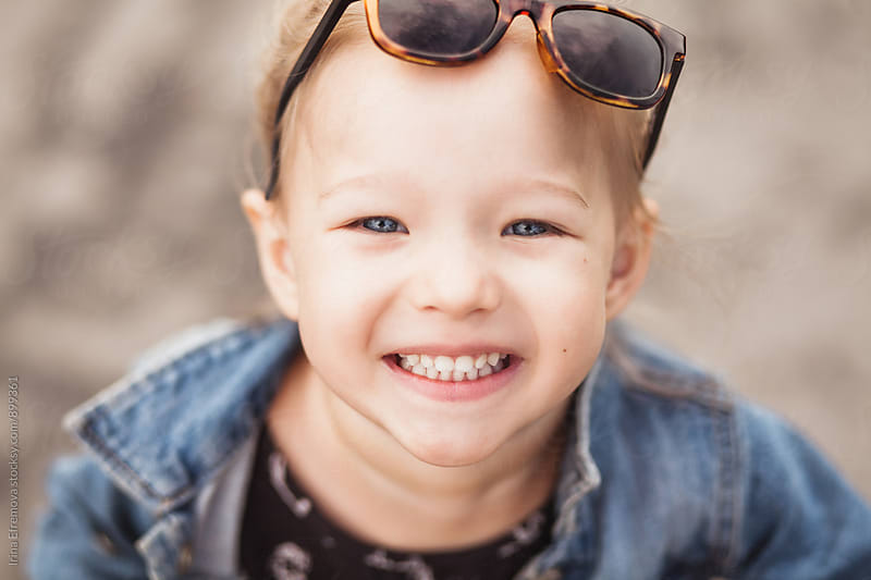 Smiling blond 3 year old girl smiling at the camera by Irina Efremova for Stocksy United