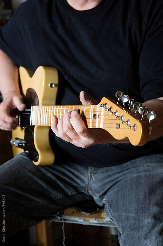 Man playing his telecaster guitar by Curtis Kim for Stocksy United