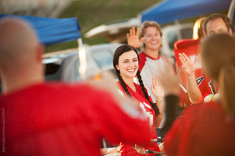 Tailgating: Friends Show Up at Tailgate Party by Sean Locke for Stocksy United
