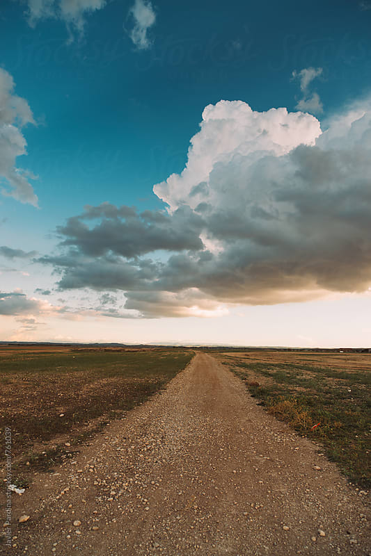 landscape with rural road and clouds by Javier Pardina for Stocksy United