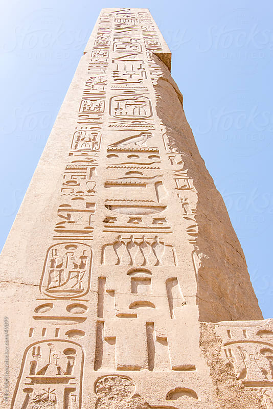 A tall obelisk in Egypt with carved hieroglyphic writing. by Mike Marlowe for Stocksy United