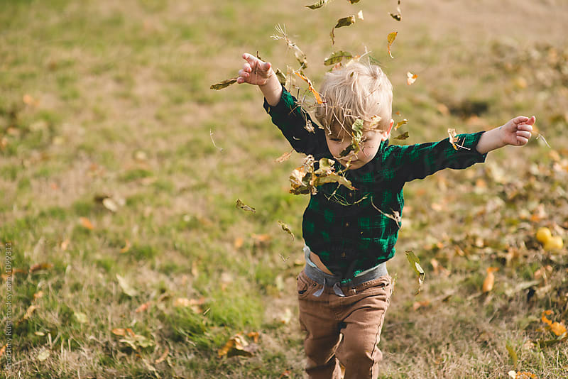 Throwing leaves by Courtney Rust for Stocksy United
