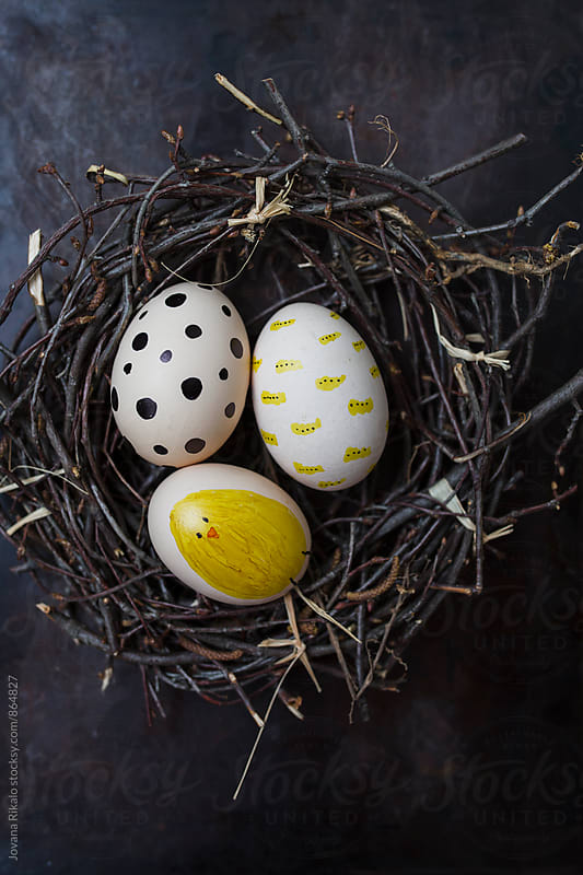 Decorated Easter eggs in a nest by Jovana Rikalo for Stocksy United