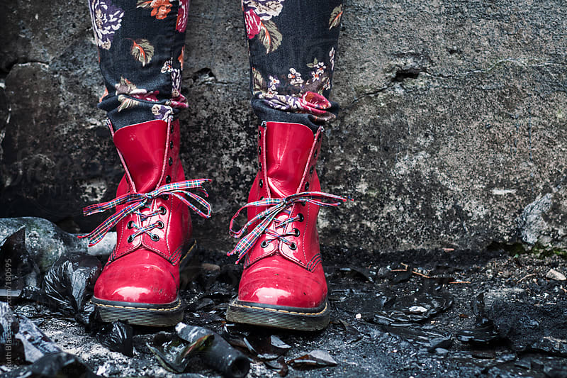 Shiny red boots by Ruth Black for Stocksy United