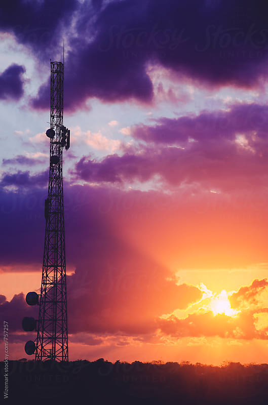 Telecommunication tower during dramatic sunrise  by Wizemark for Stocksy United