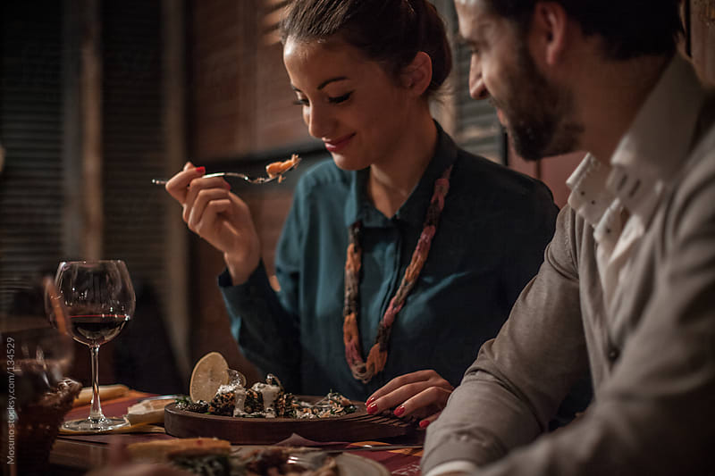 Couple Having Dinner on a Date by Mosuno for Stocksy United