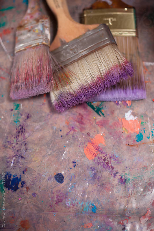 Well loved paint brushes in the art studio by Carolyn Lagattuta for Stocksy United