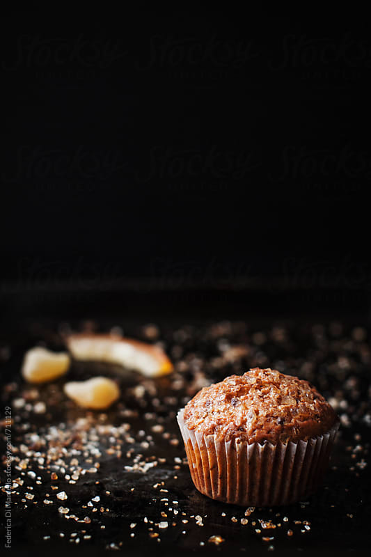 Muffins with candied orange peel and ginger      by Federica Di Marcello for Stocksy United