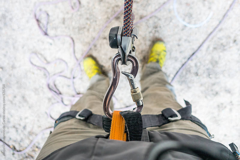 POV view of a man belaying in rock climbing by Alejandro Moreno de Carlos for Stocksy United