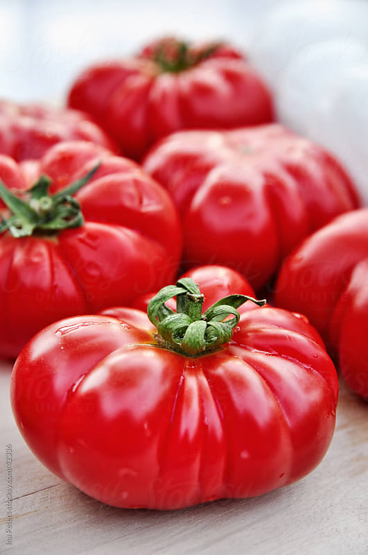 Food: Bulls heart tomatos by Ina Peters for Stocksy United