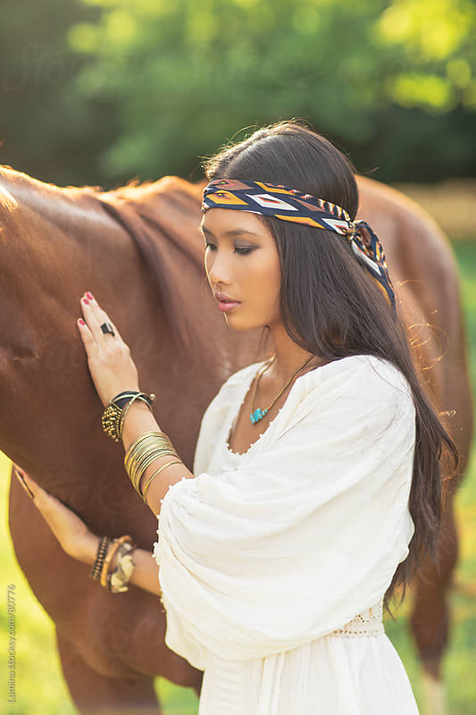 Hippie Asian Woman With Her Horse  by Lumina for Stocksy United