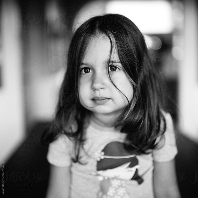 Black and white portrait of a cute young girl  by Jakob for Stocksy United