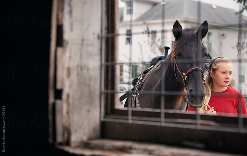 Equestrian: Girl Leading Horse By Bridle by Sean Locke for Stocksy United