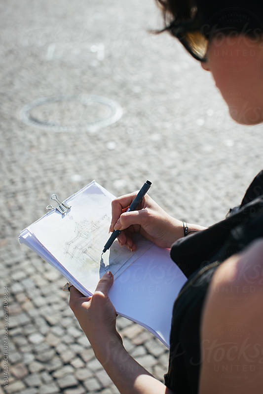 Close Up of Young Artist Drawing Berlin's Brandenburg Gate by VISUALSPECTRUM for Stocksy United