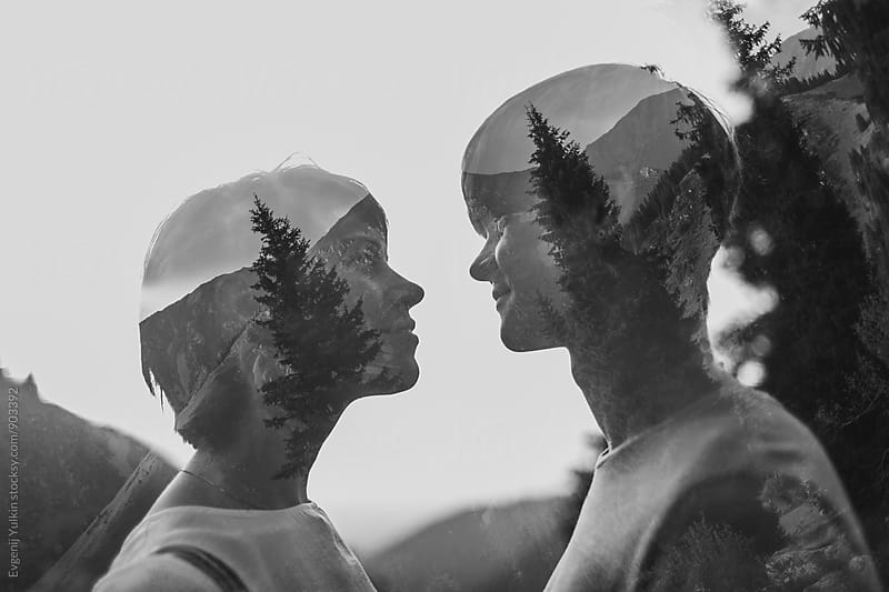 Double exposure of young couple by Evgenij Yulkin for Stocksy United