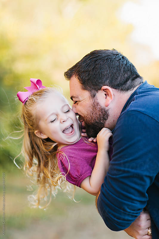 Daddy and his little girl playing in the park by Kristen Curette Hines for Stocksy United