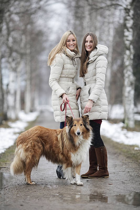 Two sisters and a collie dog by rolfo for Stocksy United