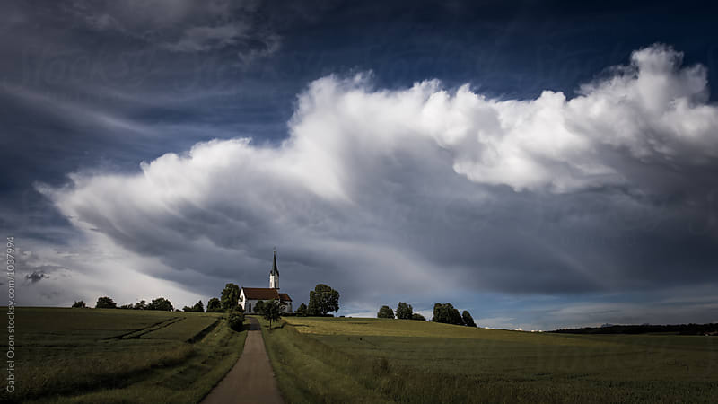 Clouds over Cornfield by Gabriel Ozon for Stocksy United