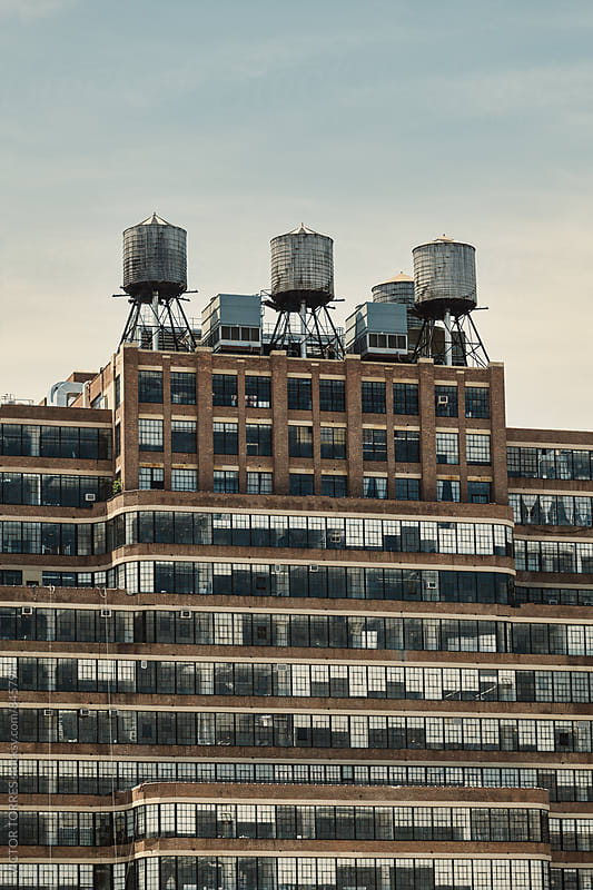 Water Tanks on a Rooftop of a Building by Victor Torres for Stocksy United