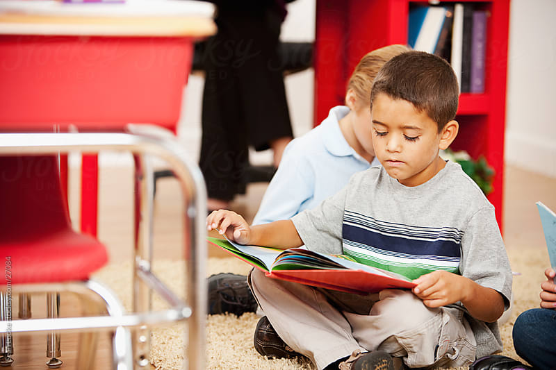 Classroom: Hispanic Boy Reading Story by Sean Locke for Stocksy United