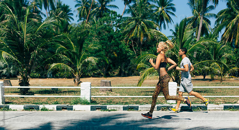 Sporty Couple Jogging Together by Lumina for Stocksy United