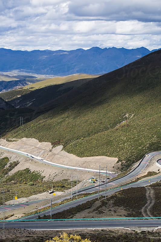 Tibet mountain road by zheng long for Stocksy United