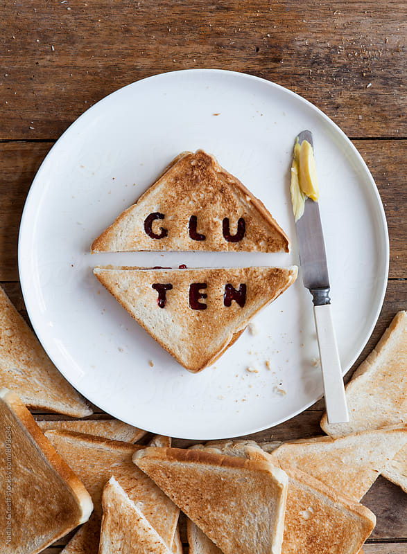 Plate with gluten bread by Nadine Greeff for Stocksy United