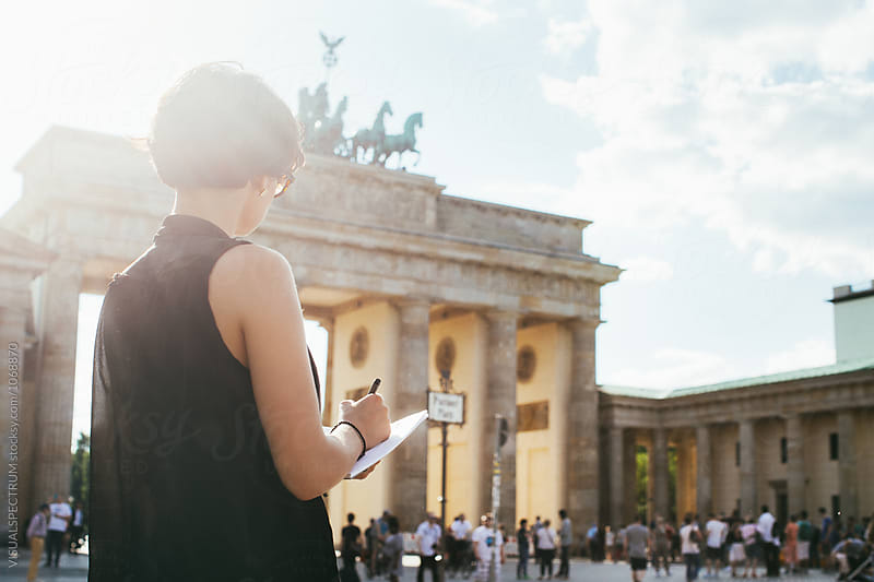Berlin - Young Female Tourist Drawing Berlin's Brandenburg Gate on Sunny Day by Julien L. Balmer for Stocksy United
