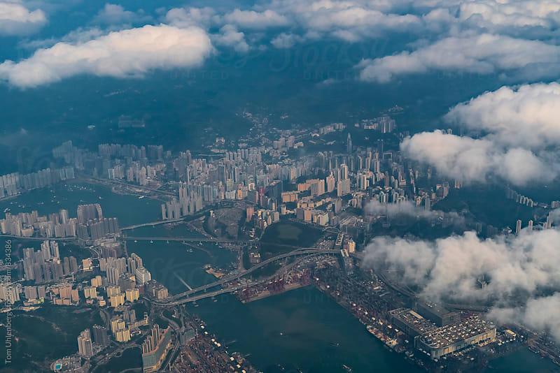 Flying above Hong Kong by Tom Uhlenberg for Stocksy United