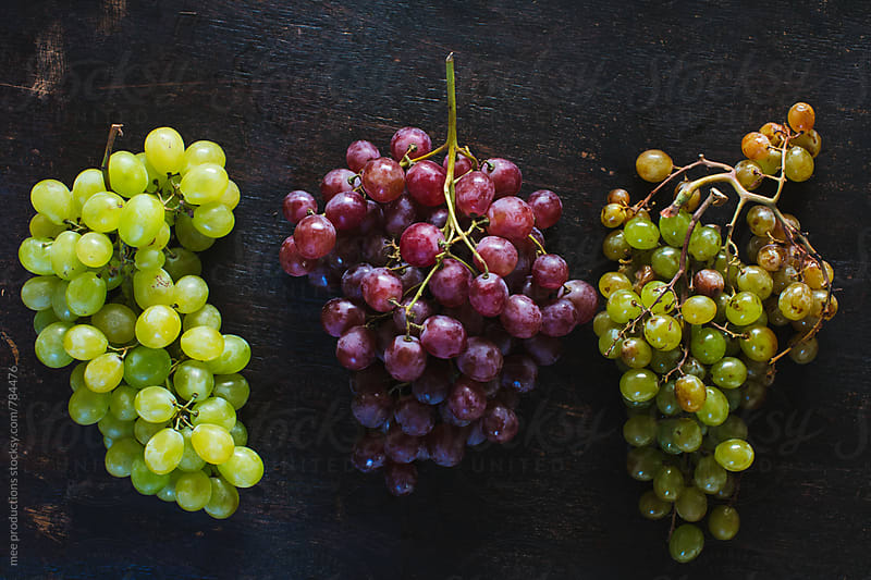 Grapes still life on wooden table by mee productions for Stocksy United